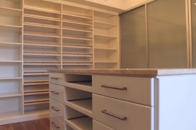 Shoe Shelves and Closet Island with slide out shelves