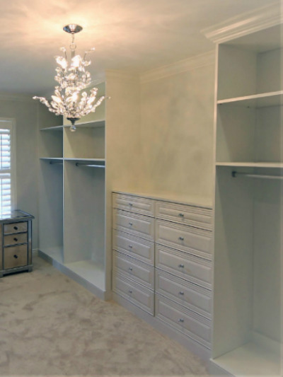 white closet organizer with crown molding
