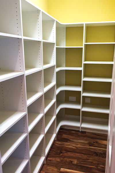 Large walk-in pantry with radius shelves in San Marco